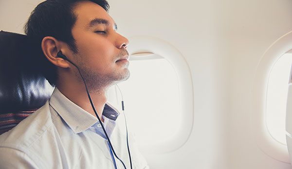 Man sleeping on a plane